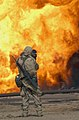 US Navy 030328-M-0000X-075 A U.S. Marine Corps Journalist assigned to the 22nd Mobile Public Affairs Detachment gets a close shot with his camera of an oil fire at the Ramaila Oilfield, Iraq.jpg