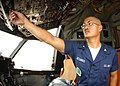 US Navy 030613-N-9662L-005 Aviation Machinist Mate 3rd Class Dexter A. Desamito from Fairfield, Calif., performs a safety check on a newly installed landing light.jpg
