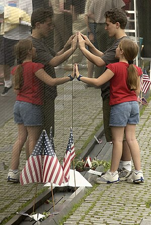 Visitors to the Vietnam Veterans Memorial Wall...