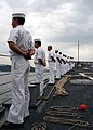 US Navy 030827-N-7267C-003 Sailors man the rails of the guided missile frigate as it pulls into Kure, Japan for a brief port visit.jpg
