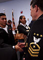 US Navy 031031-N-5576W-011 Master Chief Petty Officer of the Navy (MCPON) Terry Scott congratulates Honor Recruit Seaman Recruit Louis Toy, from Pensacola, Fla., during the honor recruit reception held at Recruit Training Comma.jpg