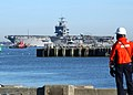 US Navy 040229-N-7097H-002 A dockmaster watches as the nuclear powered aircraft carrier USS Enterprise (CVN 65) approaches the pier at her homeport of Naval Station Norfolk, Va.jpg