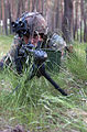 US Navy 040610-N-1823S-351 A German Army infantryman applies covering fire during woodland assault training.jpg