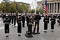US Navy 041013-N-2147L-001 Commander, Naval District Washington, Rear Adm. Jan C. Gaudio, and President and CEO of the U.S Navy Memorial Foundation, Retired Rear Adm. Pierce J. Johnson, place a wreath in front of The Lone Sailo.jpg