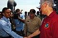 US Navy 050220-N-5067K-018 Former President William J. Clinton shakes the hand of Seaman Yandy Hernandez as he congratulates him aboard the amphibious dock landing ship USS Fort McHenry (LSD 43).jpg