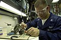 US Navy 050522-N-1730J-060 Aviation Electronics Technician 3rd Class Dave Steiner of Foley, Minn., repairs a pitch drive assembly for a radar system aboard USS Nimitz (CVN 68).jpg