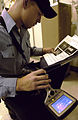 US Navy 050524-N-8213G-009 Electrician's Mate Fireman Kenneth Kimbrell from Temple, Texas, checks the fuse temperature on an infrared thermal camera used for maintenance.jpg