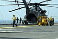 US Navy 050829-N-8154G-082 Crew members assigned to the Blackhawks of Helicopter Mine Countermeasures Squadron Fifteen (HM-15), stationed at Naval Air Station Corpus Christi, Texas, prepare to unload personnel and equipment.jpg