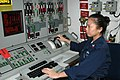 US Navy 051211-N-0000L-001 Gas Turbine System Technician 2nd Class Leslie V. Cachero stands watch at the Propulsion Auxiliary Control Console aboard the guided missile destroyer USS Donald Cook (DDG 75).jpg