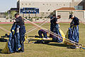US Navy 060315-N-3271W-001 U.S. Navy Parachute Team Leap Frogs crew members repack their gear after a jump at the Willow Canyon High School, during Phoenix Navy Week festivities.jpg
