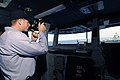 US Navy 061031-N-5330L-160 Quartermaster Seaman Richard Armstrong, a Sailor on board the Nimitz-class aircraft carrier USS Dwight D. Eisenhower (CVN 69), uses a sextant on the bridge aboard the Enterprise-class aircraft carrier.jpg