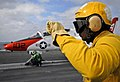 US Navy 070201-N-0336C-035 An aviation boatswain's mate signals for the pilot of a T-45 Goshawk training aircraft to stop taxiing while preparing to launch from bow catapult number one during flight operations on board Nimitz-c.jpg