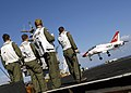 US Navy 070328-N-9742R-051 Landing signal officers direct the landing of a T-45 Goshawk, a two-seat, single-engine carrier training jet assigned to Training Air Wing (TW) 1, from the landing area of the nuclear-powered aircraft.jpg