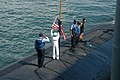 US Navy 070504-N-7955L-298 Sailors assigned to fast attack submarine USS Memphis (SSN 691) lower the ensign before departing Port Everglades.jpg