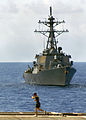 US Navy 070529-N-5067K-028 A Marine runs the flight deck of amphibious transport dock USS Juneau as Arleigh Burke-class destroyer USS Paul Hamilton (DDG 60) steams alongside.jpg
