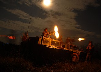 Final protective fire - Two gunners from Naval Mobile Construction Battalion (NMCB) 1 convoy security teams fire the rest of their rounds following the final protective fire scenario of the Battalion's field exercise at Camp Shelby. (June 27, 2007).