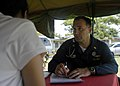 US Navy 070703-N-1752H-100 Capt. Scott Flinn, the Pacific Partnership Medical Contingent Mission Commander, performs a routine check up for a local patient during a medical-dental civic-affairs program held at Tabaco Elementary.jpg
