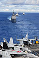 US Navy 070814-N-0890S-011 USS Princeton (CG 59), USS John Paul Jones (DDG 53), and USS Pinckney (DDG 91) transit behind the nuclear-powered aircraft carrier USS Nimitz (CVN 68) during a joint photo exercise.jpg