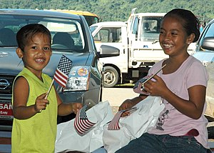 US Navy 070820-N-1467K-048 Micronesian children wave American flags during a medical civic action program at the Lelu town government building during Pacific Partnership.jpg