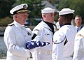 US Navy 070828-N-8395K-002 Retired Vice Adm. Al Konetzni receives the American flag from a member of the U.S. Navy Ceremonial Guard.jpg
