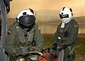US Navy 071023-N-3069F-002 Chief Aviation Electronics Technician Rexford Sackett, left, and Aviation Warfare Systems Operator 3rd Class William Quadrino prepare a 420-gallon extinguishing trough used to dump water on the wildfi.jpg