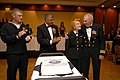 US Navy 081011-N-9818V-082 Master-At-Arms Seaman Jerry Ogg joins Master Chief Petty Officer of the Navy (MCPON) Joe R. Campa Jr., Senior Chief Rena Estes and Lt. Cmdr. Lew Katz to cut the Navy's birthday cake.jpg