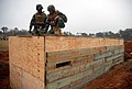 US Navy 081113-N-7367K-005 Steelworker Constructionman Recruit Nicholas Woodruff and Builder Constructionman Apprentice Domonic Fitzpatrick work together to help build a timber bunker.jpg
