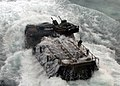 US Navy 090629-N-7058E-042 An amphibious assault vehicle transporting U.S. Marines and Malaysian Army soldiers from the 9th Royal Malay Regiment splashes into the water after launching.jpg
