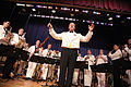 US Navy 090702-N-3271W-092 Lt. Carl Gerhard, director of the U.S. Navy Band Northeast leads the audience in singing the national anthem prior to a concert at Somerville High School.jpg