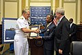 US Navy 090727-N-8273J-054 Chief of Naval Operations (CNO) Adm. Gary Roughead, left, and Secretary of the Navy (SECNAV) the Honorable Ray Mabus, right, are presented a commemorative copy of the Congressional Remarks by Senator.jpg