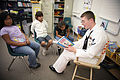 US Navy 090915-N-3271W-026 Cryptologic Technician 2nd Class Sean Wilkins of Navy Recruiting District Portland, reads to children that are taking part in an Indian Education after school program.jpg