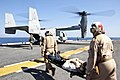 US Navy 100123-N-8936G-040 Hospital Corpsmen 3rd Class Joseph Williams and Hospital Corpsman 3rd Class Alejandro Calzada, assigned to the Golden Eagles of Marine Medium Tiltrotor Squadron (VMM) 162 (Reinforced), carry an injure.jpg