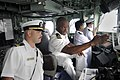 US Navy 100313-N-8335D-059 Lt. Cmdr. Walter Mainor, the commanding officer of the mine-counter measures ship USS Patriot (MCM 7,) talks with the officer of the deck.jpg
