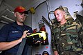US Navy 100708-N-3154P-005 Damage Control Fireman Robert Trainor familiarizes Quartermaster Seaman Shane Perritt on the usage of the naval firefighting thermal imager.jpg