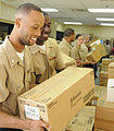 US Navy 100727-N-0864H-149 Ship's Serviceman Seaman Quinton Lewis hands a box of Project Handclasp medical supplies to Ship's Serviceman 3rd Class Leo Williams.jpg