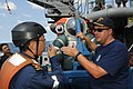 US Navy 100823-N-9204B-031 Cmdr. David Lemly discusses the atmospheric diving suit with the Republic of Singapore Chief of the Navy Rear Adm. Chew Men Leong aboard USNS Safeguard (T-ARS 50).jpg