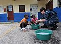 US Navy 110421-F-ET173-114 Lt. Danna Convoy, from Camp Lejeune, N.C., teaches children how to wash their hands during a Continuing Promise communit.jpg