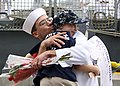 US Navy 110916-N-ZI300-193 Ship's Serviceman 2nd Class Nimitz Martin, assigned to the guided-missile frigate USS Thach (FFG 43), hugs his son after.jpg