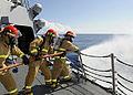 US Navy 111022-N-VH839-031 Sailors aboard the Arleigh Burke-class guided-missile destroyer USS Wayne E. Meyer (DDG 108) discharge a fire hose.jpg