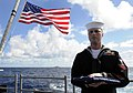 US Navy 111207-N-BC134-042 Information System Technician 2nd class Nathaniel Petri carries the national ensign during a burial at sea aboard the g.jpg
