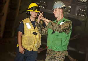 US Navy 111211-N-PB383-631 A Sailor speaks with a Marine while conducting amphibious operations.jpg