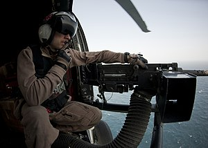 US Navy 120213-N-DR144-442 Naval Air Crewman Airman Terry Warren, assigned to Helicopter Anti-Submarine Squadron (HS) 15, mans a .50 caliber machin.jpg