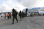 Ugandan troops arrive at Mogadishu Airport on Int'Air Îles Airbus A320 (ZS-GAS) (2).jpg