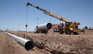 English: Unloading large diameter galvanized 9...