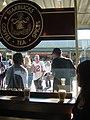 View of Singing Men Outside Starbucks (6299606).jpg