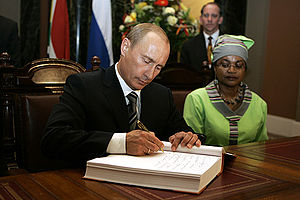 English: CAPE TOWN. President Vladimir Putin s...