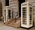 WHITE CLASSIC PHONE BOXES OF THE HULL TELEPHONE COMPANY HULL TOWN CENTRE EAST YORKSHIRE SEP 2013 (9697186489).jpg