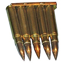 five cartridges held together at their bases by a strip of metal