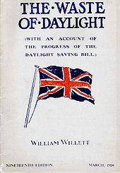 Pamphlet cover showing a large British flag in red, white, and dark blue, with the large title «THE WASTE OF DAYLIGHT», an unreadable subtitle, and «WILLIAM WILLETT» near the bottom.