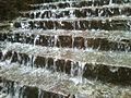 Water flowing through steps on walkway to Simhachalam.jpg
